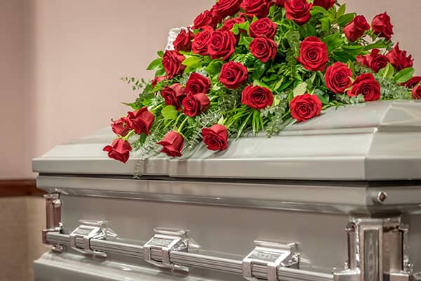 casket with red roses